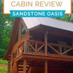 Log cabin set in the trees with the title Hocking Hills Cabin Review - Sandstone Oasis